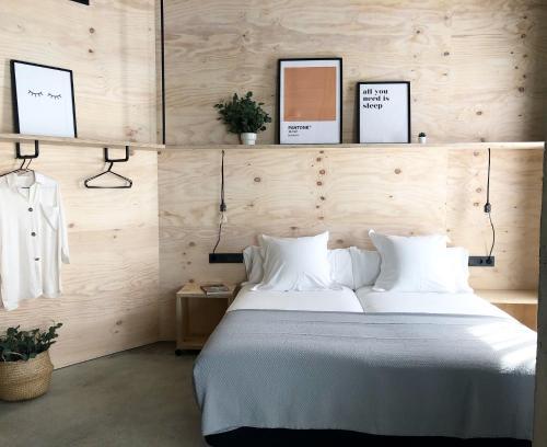 Cama o camas de una habitación en Talo Urban Rooms