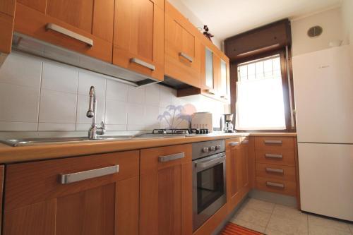 Cucina o angolo cottura di Strale Family Apartment