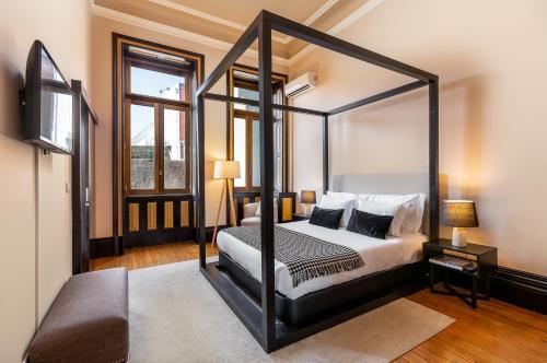 Ein Bett oder Betten in einem Zimmer der Unterkunft Your Opo Bolhao Apartments