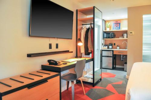 A television and/or entertainment center at Infinity Hotel SF, Ascend Hotel Collection