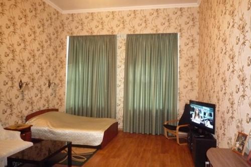 Телевизор и/или развлекательный центр в Апартаменты на Ул. Шпалерная, д. 26