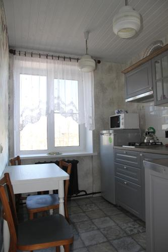 A kitchen or kitchenette at Peterhof Apartments