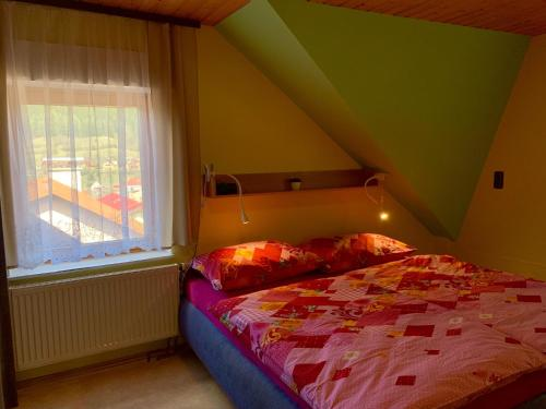 Postel nebo postele na pokoji v ubytování Ubytování U Přehrady