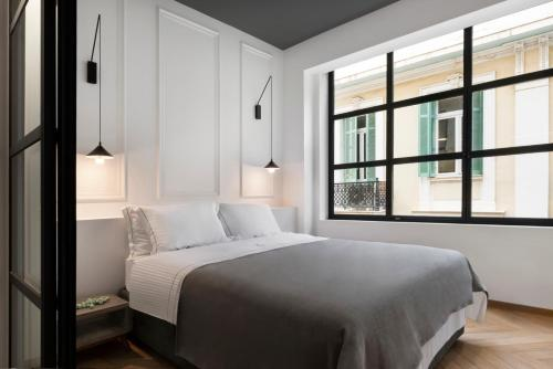 A bed or beds in a room at La Maison Athenes