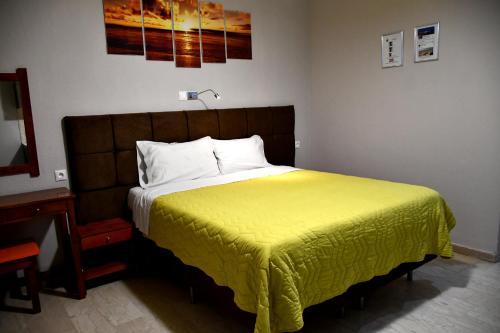 Ένα ή περισσότερα κρεβάτια σε δωμάτιο στο Seaview