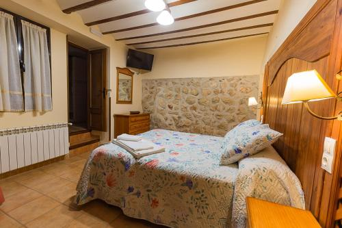A bed or beds in a room at Apartamento de Elvira