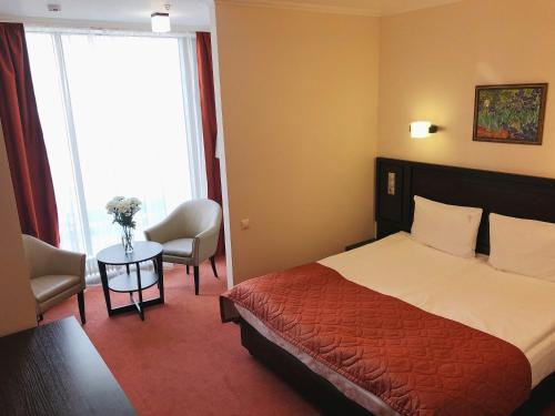 A bed or beds in a room at Hotel Elokhovsky City