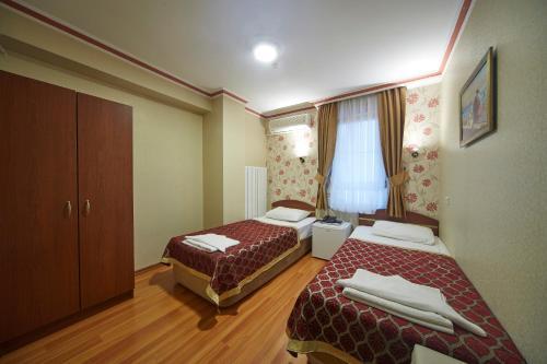 Un ou plusieurs lits dans un hébergement de l'établissement Hotel Akcinar