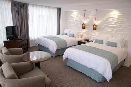 ホテル プレジデンテにあるベッド