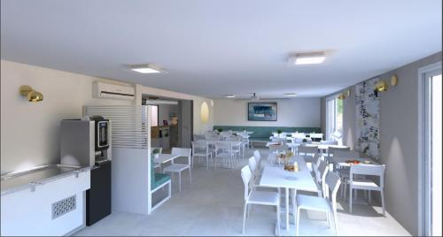 A restaurant or other place to eat at Kyriad Montpellier Sud - A709