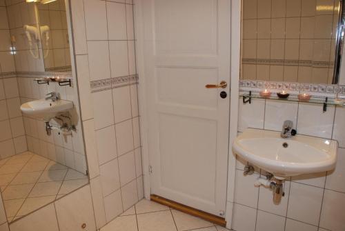 A bathroom at Central City Hostel