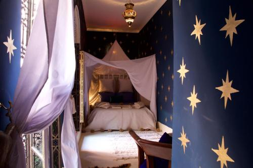 A bed or beds in a room at The Bohemian Jungle