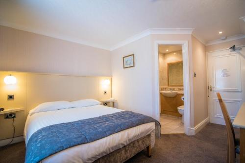 A bed or beds in a room at Astley Bank Hotel