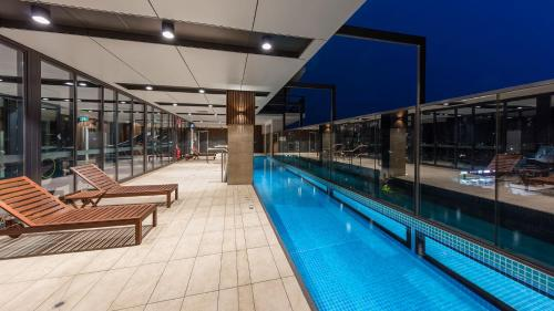 The swimming pool at or near Avani Adelaide Residences