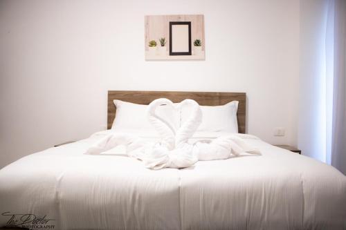Aqua Palms Resort (Apartments and Villas)にあるベッド