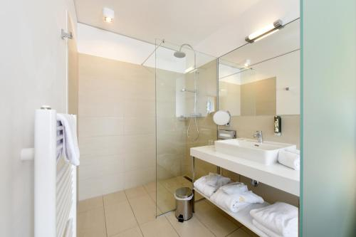 A bathroom at AMEDIA Luxury Suites Graz I contactless check-in