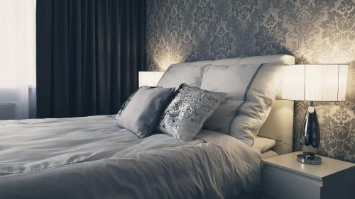 A bed or beds in a room at Silver Apartaments