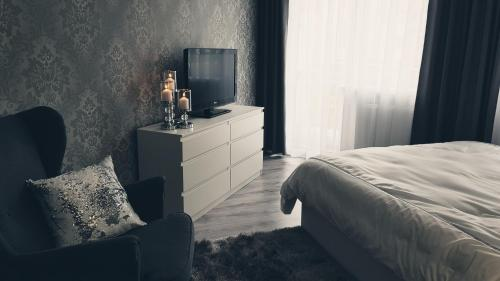 A television and/or entertainment centre at Silver Apartaments