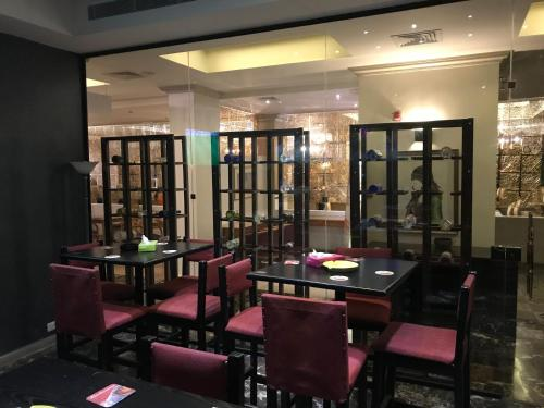 A restaurant or other place to eat at Grand Hotel Madaba