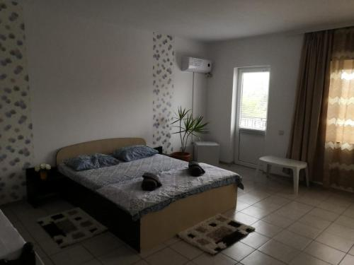 A bed or beds in a room at Casa Antonia