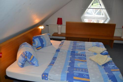 A bed or beds in a room at Apartmány Holiday Pec