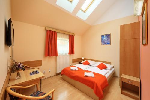 Ένα ή περισσότερα κρεβάτια σε δωμάτιο στο Residence Tabor