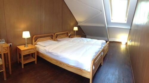 A bed or beds in a room at New Helvetia Hotel