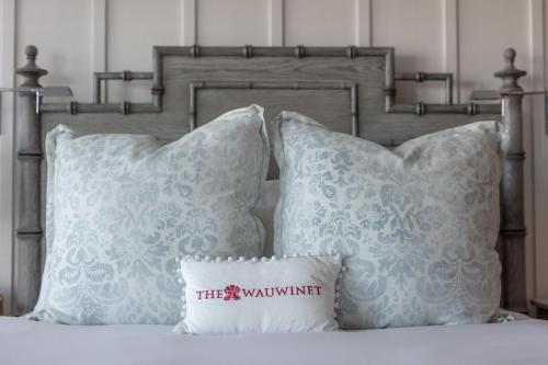 A bed or beds in a room at The Wauwinet Nantucket