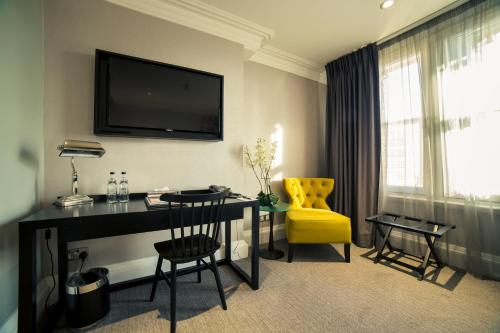 A television and/or entertainment center at Grey Street Hotel