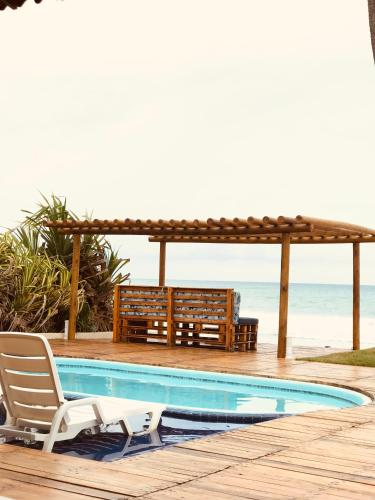 The swimming pool at or close to Maresia Suites Beira Mar