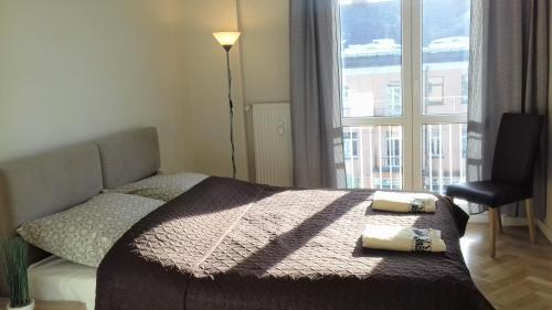 A bed or beds in a room at APARTAMENT CENTRUM Lipowa 16