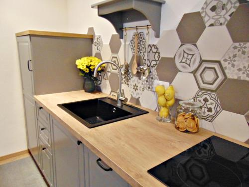 A kitchen or kitchenette at Apartments Glam
