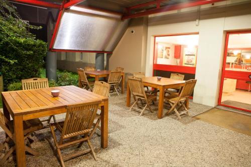 Een restaurant of ander eetgelegenheid bij Hotel ClassEco Gent