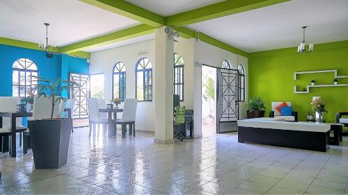 The lobby or reception area at Villa del Angel Hotel