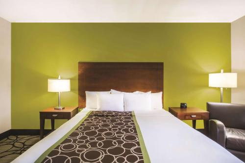 A bed or beds in a room at La Quinta by Wyndham Conference Center Prescott