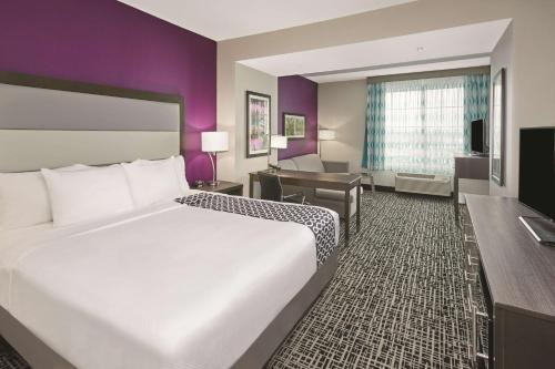 A bed or beds in a room at La Quinta by Wyndham Springfield IL