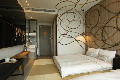 承億文旅-桃城茶樣子房間的床