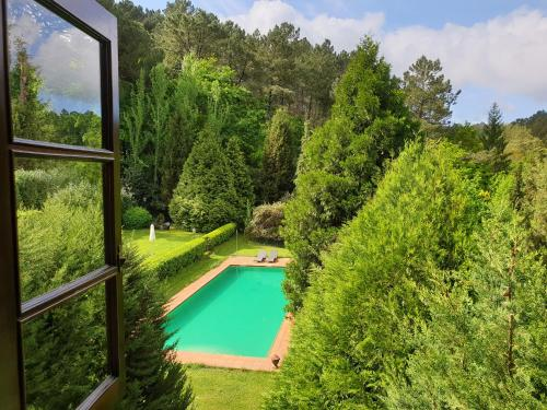 A view of the pool at Pazo de Bentraces or nearby