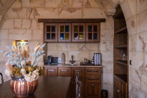 A kitchen or kitchenette at Kayakapi Premium Caves Cappadocia
