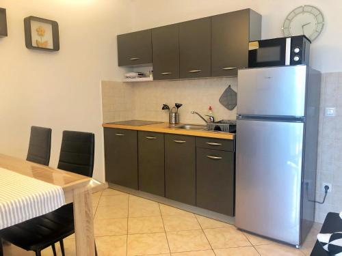 A kitchen or kitchenette at Apartment Rabac