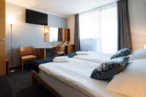 Łóżko lub łóżka w pokoju w obiekcie Hotel GH Kolinska