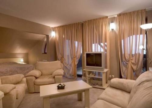 Кът за сядане в Hotel Temenuga