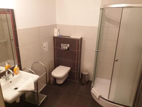 Łazienka w obiekcie Pokoje Gościnne CYKADA
