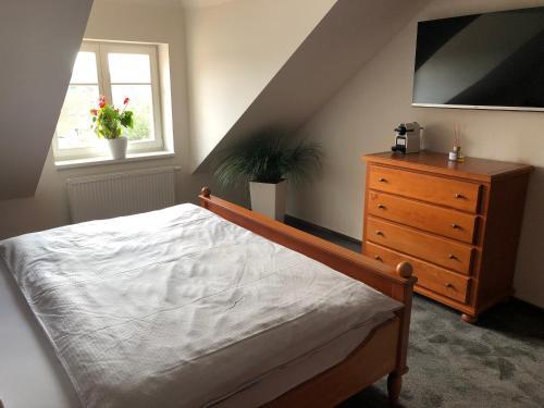 Posteľ alebo postele v izbe v ubytovaní náměstí Tomáše Garrigue Masaryka