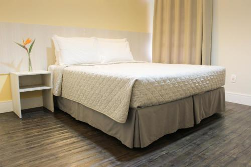 A bed or beds in a room at CEIC Pousada e Eventos