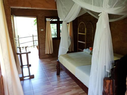 A bed or beds in a room at On The Rocks Bungalows & Restaurant