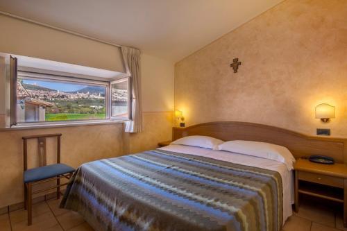 Letto o letti in una camera di Hotel Bellavista