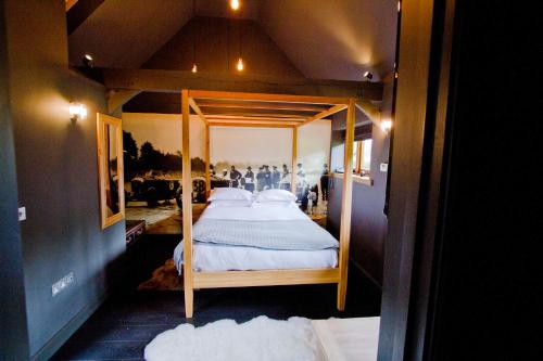 A bed or beds in a room at The White Horse