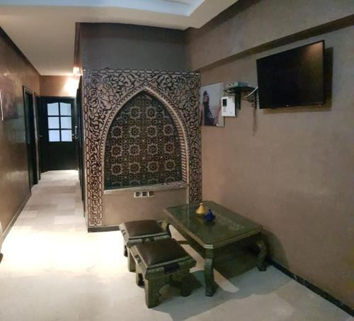 A television and/or entertainment center at Beautiful apartment in Gueliz, Marrakech