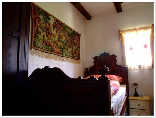 A bed or beds in a room at Tradicije Cigoc